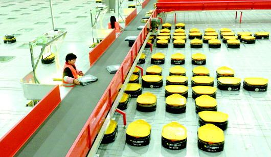 快递业渐高能 机器人包装盒能共享能回收