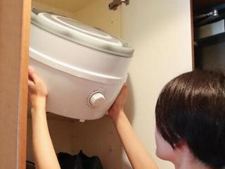 洗衣机可以有多小?折一下就能塞进柜子里